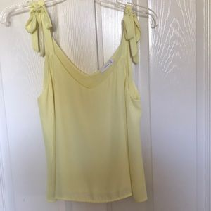 Lush light yellow chiffon tank top with bow detail